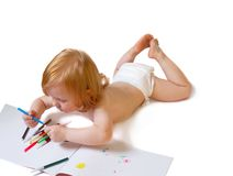 El bebé con el álbum y suave-inclina la pluma Fotos de archivo libres de regalías