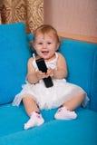 El bebé con el teléfono Foto de archivo libre de regalías