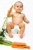 El bebé con la zanahoria Fotografía de archivo libre de regalías