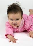 El bebé dulce se vistió en color de rosa Foto de archivo libre de regalías