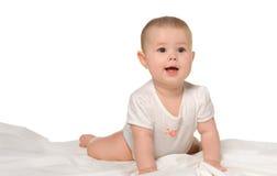 El bebé en un bedsheet Imágenes de archivo libres de regalías