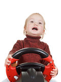 El bebé juega con la rueda del juego, aislada en blanco Fotografía de archivo libre de regalías