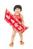 El bebé que se sostiene enhorabuena aspa por Año Nuevo chino Fotografía de archivo