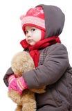 El bebé en invierno arropa en un fondo blanco Imagen de archivo libre de regalías