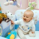El bebé primero se sienta Foto de archivo libre de regalías