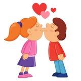 El besarse del muchacho y de la muchacha Imagen de archivo libre de regalías