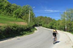 El Biking cuesta arriba Fotografía de archivo libre de regalías
