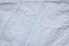 El blanco arrugó el fondo de la textura de la materia textil del paño Fotos de archivo