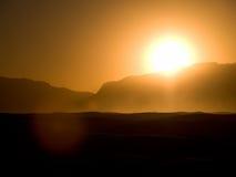 El blanco enarena la puesta del sol 2 Fotografía de archivo