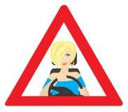 El blonde detrás de la rueda Foto de archivo