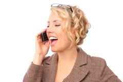 El blonde hermoso con el teléfono Fotos de archivo libres de regalías