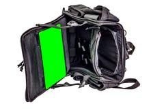 El bolso del ` s del bombero con un sistema modular para llevar el equipo militar lleno, negro, aisló - vea dentro fotos de archivo