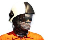 El bombero en industria del petróleo y gas, el bombero acertado en el trabajo, el traje del fuego para el combatiente con el fueg Fotos de archivo libres de regalías