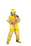 El bombero rescató al niño del fuego Foto de archivo libre de regalías