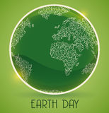 El botón brillante con brilla intensamente en conmemoración del Día de la Tierra, ejemplo del vector Imagen de archivo