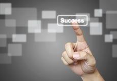 El botón del éxito del presionado a mano Imagen de archivo