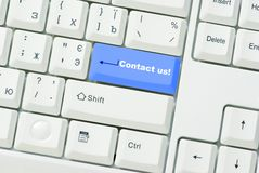El botón nos entra en contacto con Foto de archivo
