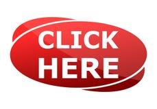 El botón rojo hace clic aquí Imagen de archivo libre de regalías
