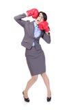 El boxeo y golpea abajo sí mismo de la mujer de negocios Foto de archivo libre de regalías
