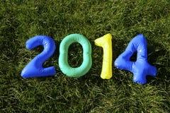 El Brasil colorea el mensaje 2014 en fondo de la hierba Foto de archivo libre de regalías