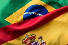El Brasil y España Bandera del Brasil y bandera de España Fotos de archivo libres de regalías