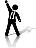 El brazo y el puño del hombre de negocios celebran éxito de asunto Imagenes de archivo