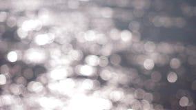El brillar de plata abstracto hermoso enciende el fondo de la Navidad del bokeh 3840x2160 almacen de metraje de vídeo