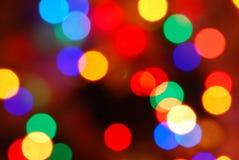 El brillar intensamente de las luces de la Navidad (fondo del movimiento de la falta de definición) Imagen de archivo libre de regalías