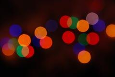 El brillar intensamente de las luces de la Navidad (fondo del movimiento de la falta de definición) Fotografía de archivo