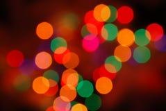 El brillar intensamente de las luces de la Navidad (fondo del movimiento de la falta de definición) Imagen de archivo