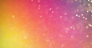 El brillo digital de la Navidad chispea el bokeh de las partículas del multicolor que fluye en el fondo colorido, Feliz Año Nuevo