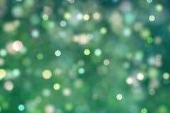El brillo digital de la Navidad chispea las partículas amarillas verdes BO del color Fotos de archivo