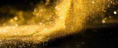 El brillo enciende el fondo del grunge, abstrac defocused del brillo del oro foto de archivo