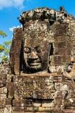 El Buddah de piedra hace frente en el templo de Bayon en el complejo de Angkor, Camboya Fotos de archivo libres de regalías