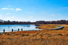 El caballete de madera en el lago del sol Imagen de archivo