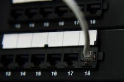 El cable RJ11 conecta con el panel Fotografía de archivo