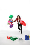 El caer adolescente con los bolsos de compras Foto de archivo