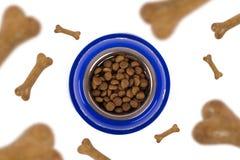 El caer de la comida de perro Foto de archivo libre de regalías