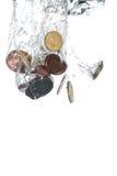El caer de las monedas Foto de archivo libre de regalías