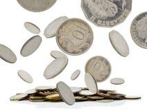 El caer de las monedas fotos de archivo