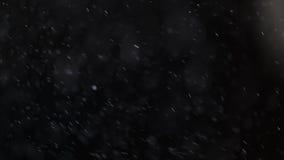 El caer de las párticulas de polvo Foto de archivo libre de regalías