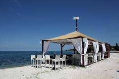 El café está en la playa Fotografía de archivo