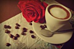 El café y subió Foto de archivo libre de regalías