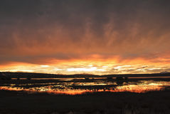 Patagonian sunset over El Calafate city. The sky is on fire. Watching the beautiful El Calafate sunset over a lake stock image