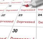 El calendario deprimido significa abajo de desanimado o Imágenes de archivo libres de regalías