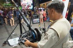 El cameraman tira a gente en Tet Foto de archivo libre de regalías