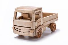 El camión es un juguete hecho de la madera natural Fotografía de archivo