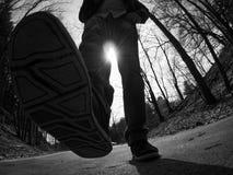 El caminar abajo de la calle Fotografía de archivo libre de regalías