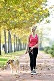 El caminar con el perro Fotografía de archivo libre de regalías