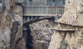 El Caminito del Rey footpath bridge long shot with tourist Royalty Free Stock Image